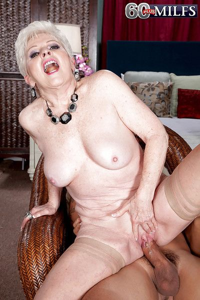 Big boobed granny Jewel taking cumshot on spread vagina in stockings