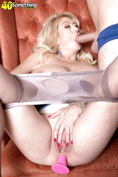 Over 40 blonde lady Tahnee Taylor giving BJ with butt plug in hose clad ass