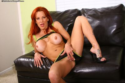 Red-haired mommy Shannon Kelly in revealing lingerie exposes her giant round tits and snatch