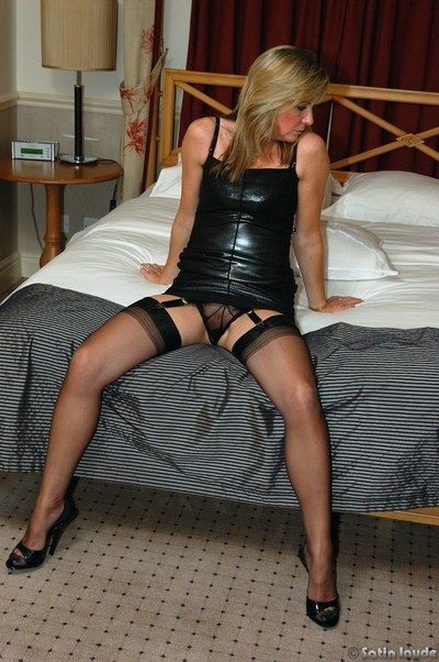 Hot mature Satin Jayde flaunting her small tits in stockings and heels