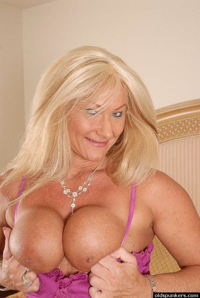 Hot granny Roxy shows up her nice-looking big boobies and ass