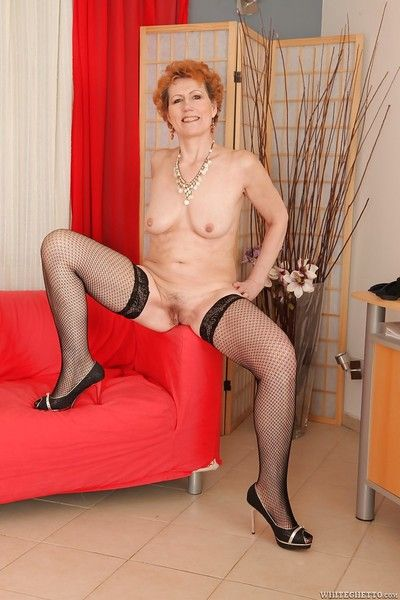 Georgina T posing in sexy lingerie and plays with mature vagina