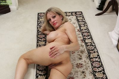 Over 50 MILF Christina Brim letting her nice mature tits looser