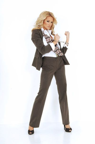 Even when wearing the suit this luxurious blonde Jessica Drake looks really erotic