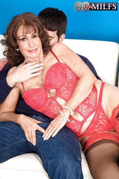 Busty granny in lingerie and stockings Jacqueline Jolie gets fucked