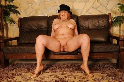 Fatty granny with big tits spreading her legs showing her wet slit