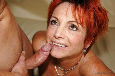 Redhead granny in nylon stockings gets shagged by a younger guy