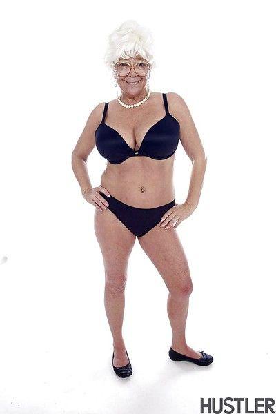 Granny pornstar Karen Summer modelling fully clothed before stripping naked
