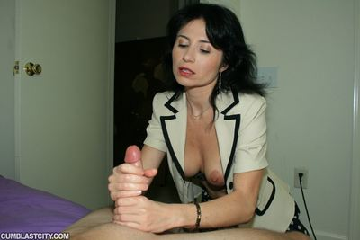 Naughty mature brunette masturbating her slit and gives a handjob