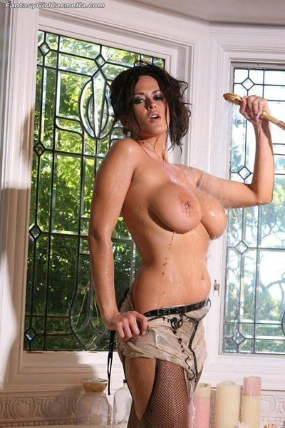 Black haired MILF Carmella Bing showers her huge tits and exposes her hairless snatch