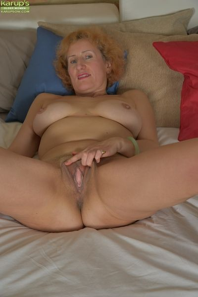Aged redhead Naomi Triplexxx showing off nice pair of granny boobs