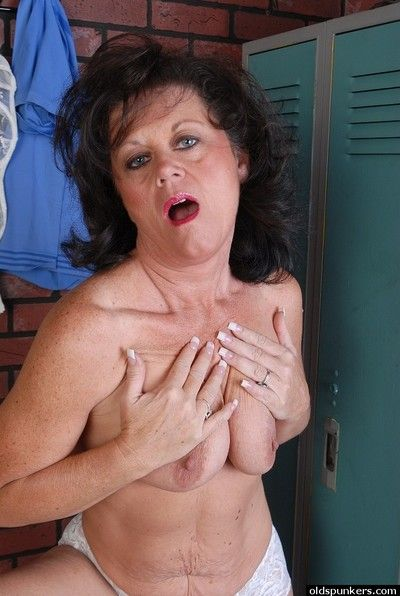 Naughty granny Debella shows off her saggy tits in the changing room