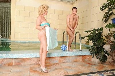 Granny slut with big tits gets out of the pool for a hot fucking