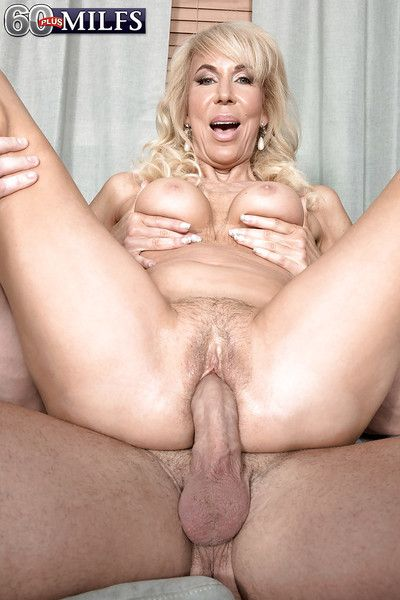 Busty blond gran Erica Lauren rides cock cowgirl style during hardcore sex