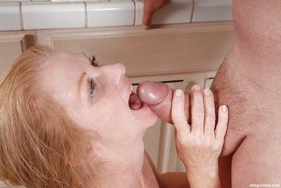 Sexy granny Tiffany dose blowjob and receives cumshot on her face