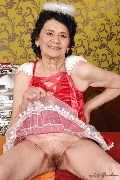 Lusty granny with no panties under her skirt showcasing her hairy cunt