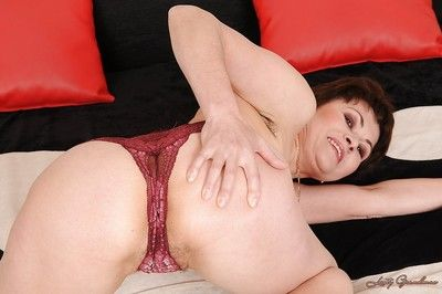 Short haired granny slipping off her lingerie and spreading her legs