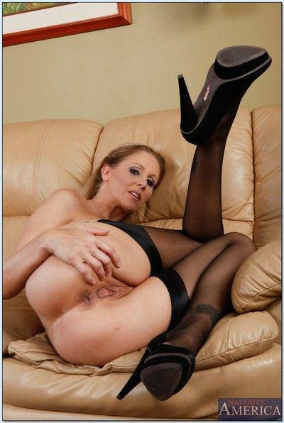 Big tits mature Julia Ann in stockings spreading legs and masturbating