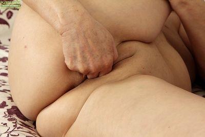 Hot granny Karoline spreading legs and finger fucking shaved mature pussy