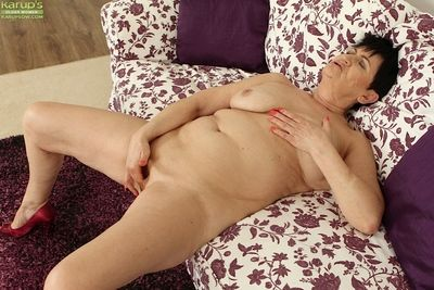 Hot granny Karoline spreading legs and finger fucking shaved mature pussy