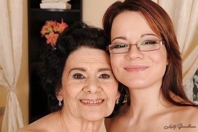 Sexy teen in glasses enjoys her lesbo sex with a very old lady