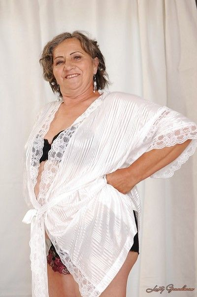 Naughty granny with fatty curves getting rid of her lingerie