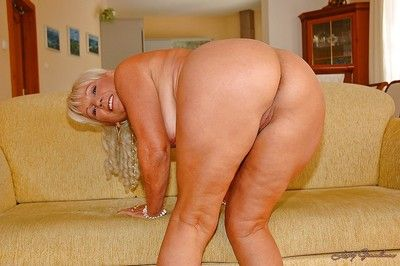 Blonde granny with a tight ass drops panties to show her hairy cunt