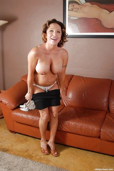 Big tits granny Luna is undressing her white panties in close up