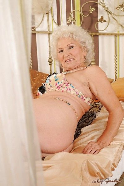 Lascivious granny in lingerie stripping and toying her hairy slit