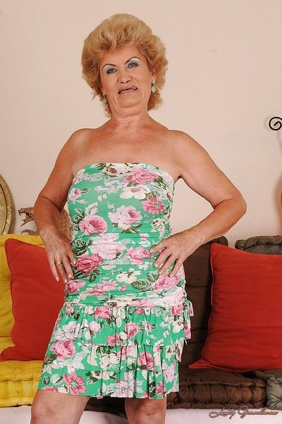 Filthy blonde granny with hairy twat stripping and spreading her legs