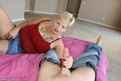Short haired amateur granny with tattooed rack gives a handjob