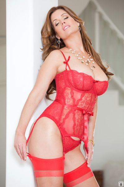 Hot mom Carrie Stevens posing seductively in sexy lingerie, stocking and heels