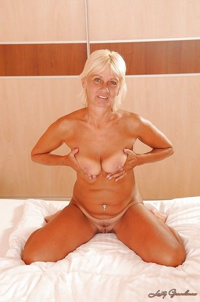 Lustful granny taking off her lingerie and spreading her lower lips
