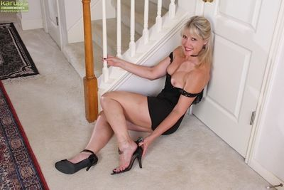 Leggy mature lady Rebecca Hill revealing pink pussy while undressing