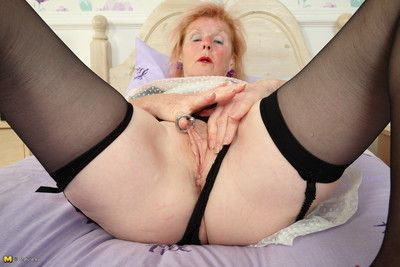 Kinky british mature lady plays with her pierced pussy