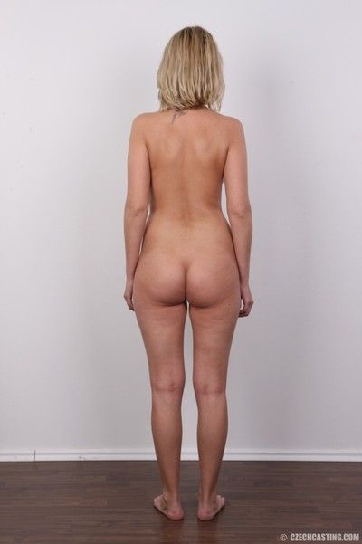 Blonde housewife posing naked for photo camera