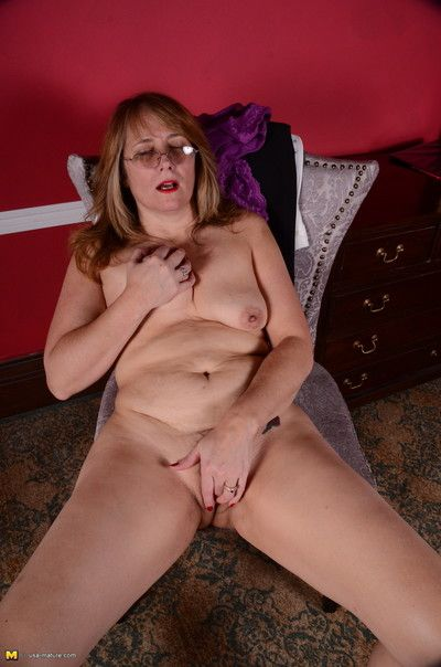 American housewife plays with her unshaved pussy