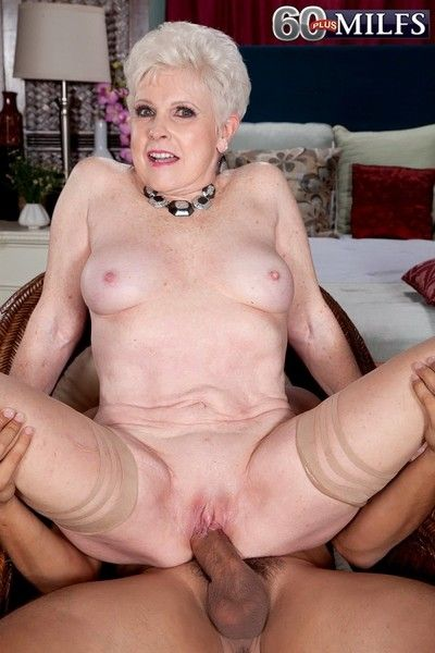 Shorthaired blonde mature riding hard cock