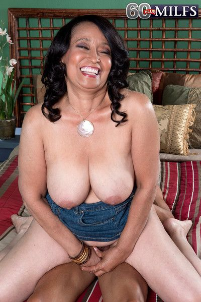 Latina mature rubs hard cock