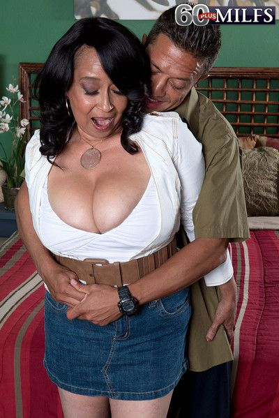 Latina mature rubs hard cock