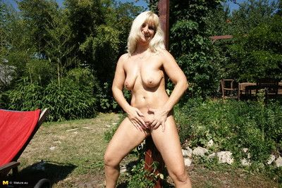 This housewife loves to play dirty in the garden