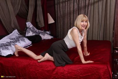 Naughty american mature lady playing alone