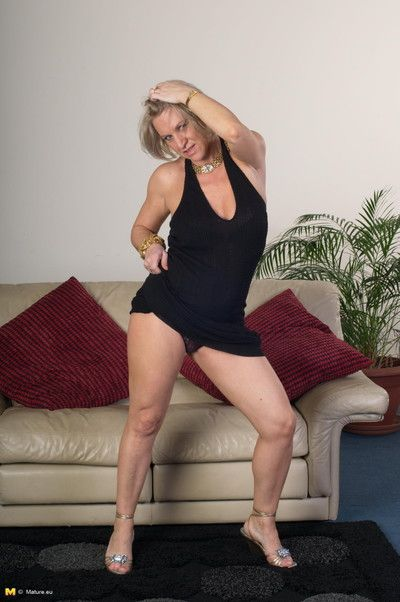 This horny housewife is grinding on her couch