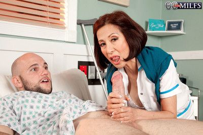 Asian mature nurse fucks with her patient