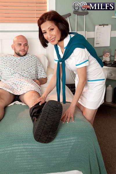 Asian mature nurse fucks with her patient