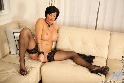 Bosomy milf in stockings Shay Fox sliding black toy between the pussy lips