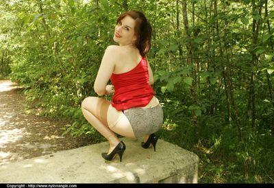 Seductive mature babe on high heels flashing her panties outdoor