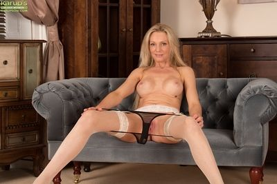 Blonde mature with big tits Angel P. takes part in close up undressing scene