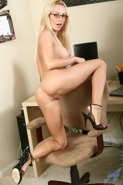 Four-eyed blonde milf Holly Sampson strips and seductively poses in the office