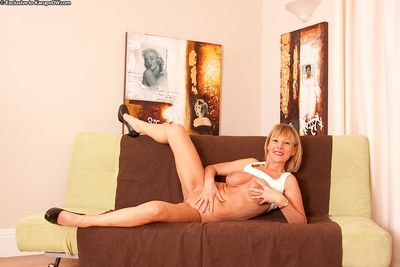 Older blonde lady Elaine revealing hooters and bare ass in high heels
